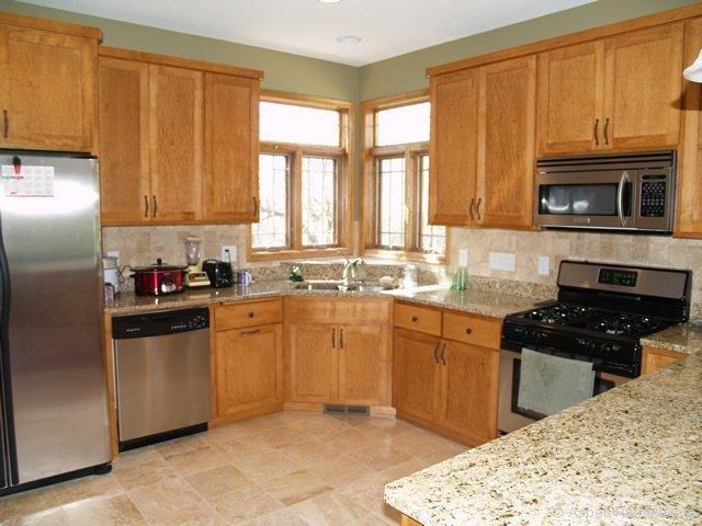 Makeover your rental kitchen cheap get bigger rents - Corner windows in kitchen ...